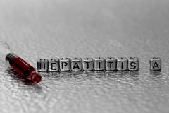 Hepatitis A on beads with blood in a syringe Royalty Free Stock Image