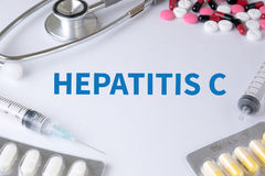 HEPATITIS C. Text, On Background of Medicaments Composition, Stethoscope, mix therapy drugs doctor flu antibiotic pharmacy medicine medical Stock Photography