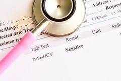 Hepatitis C virus negative test result. With stethoscope stock photos