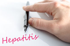 Hepatitis Concept. Pen in the hand  over white background hepatitis concept Royalty Free Stock Images