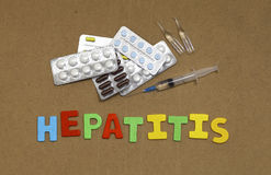Hepatitis. Drugs and the inscription letters on the board Royalty Free Stock Photo