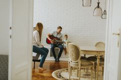 Heppy family with guitar. At home stock photo