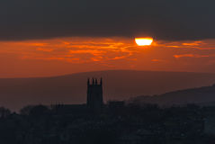 Heptonstall Church Winter Sunset. A warm winter sun sets over the hills of the South Pennines in Calderdale. silhouetting the Church in the Yorkshire village of Royalty Free Stock Photos
