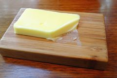 Her... Butter creamy yellow fat wood tabletop Stock Photography