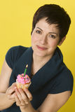Birthday Woman Shows Her Celebration Cupcake Royalty Free Stock Photo
