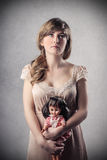 With her doll Royalty Free Stock Photography