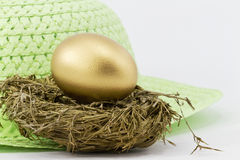Her Gold Nest Egg Stock Photos