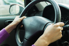 Her hands on the steering wheel Royalty Free Stock Photo