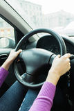 Her hands on the steering wheel Royalty Free Stock Image