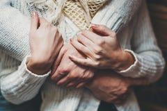 Her husband gently hugs her girlfriend Stock Photos