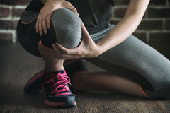 Her knee feel painful after fitness exercise, healthy lifestyle Stock Photos
