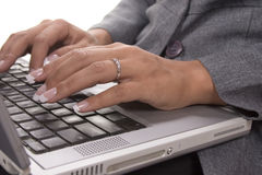 Her Laptop!. Female typing on a laptop Stock Image