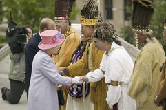 Her Majesty Queen Elizabeth II. Queen of England and the Duke of Edinburgh, Prince Philip meeting Native American Indian Ceremony and Powhatan Tribal Member in Stock Photography