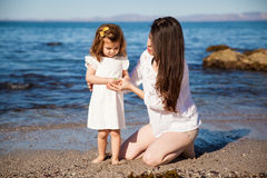 With her mom at the beach Royalty Free Stock Images