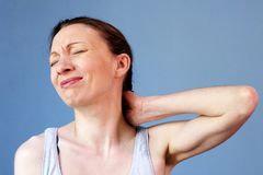 Neck pain woman work illness correct posture. Her neck was sore. Inflammation affecting many adults. Painful Neck pain can involve just the neck and shoulders stock images