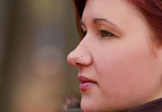 Her profile. Profile of a young girl with a nose piercing Royalty Free Stock Photos