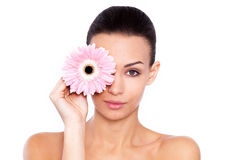 Her radiant beauty is the product of great skin care. Cropped shot of a beautiful young woman holding flower isolated on white Stock Photos