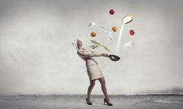 Her recipe of success . Mixed media Royalty Free Stock Photography