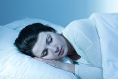 Her sleeplessness had finally gone. Shot of a young woman sleeping in her bed Stock Photo