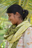 Her smile!. A female worker hides her innocent smile from the sun which is spreading it`s rays Royalty Free Stock Photos