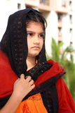 Her subtle anger. A traditional girl in an Indian village dressed in a black ethnic outfit displaying her subtle anger Stock Photography