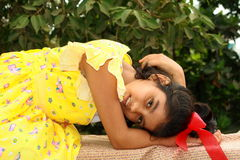 Her warm feelings. A small Indian girl with her nice warm feelings and look Stock Photos