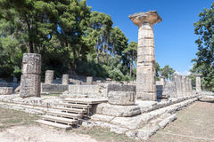 Hera Temple Olympia Greece. The hera temple ruins with a doric column and several column bases over a platform Royalty Free Stock Photography