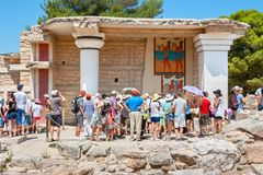 Tourists visiting Knossos palace. Crete, Greece royalty free stock image