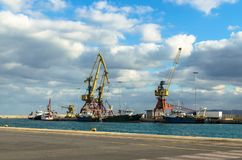 Crete, Greece - November 2, 2017: Port of Heraklion. Heraklion, Crete, Greece - November 2, 2017: In the foreground - sea and pier of the  port of Heraklion Royalty Free Stock Images