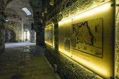 Heraklion, Crete / Greece - October 26, 2017: Interior view of the fortress `Koules`. In the light inscription we see a plan of Candia Marcian library. Candia Royalty Free Stock Photography