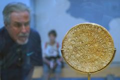 Phaistos Disc. HERAKLION, GREECE - CIRCA MAY 2018 Phaistos Disc in Acrhaeological museum royalty free stock photo
