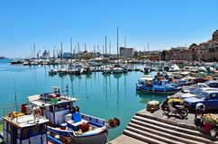 Venetian Harbor of Heraklion on the island of Crete, Greece. Heraklion, Greece - July 15, 2016: Small fishing boats and yachts are moored in the Old Venetian Royalty Free Stock Image