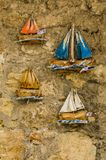 Heraklion, Greece - November, 2017: Souvenirs on the street of Heraklion, Crete. Heraklion, Greece - November, 2017: Bright, picturesque souvenirs in the form of Stock Images