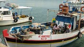 HERAKLION, GREECE - November, 2017: Greek fishermen who disassemble fishing nets, Venetian fortress, Heraklion port, Crete. HERAKLION, GREECE - November, 2017 Royalty Free Stock Photo