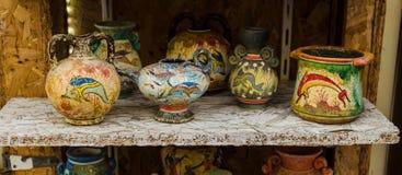 HERAKLION, GREECE - November, 2017: Greek national pottery, hand-painted, Heraklion, Crete. HERAKLION, GREECE - November, 2017: painted Greek vessels and various Royalty Free Stock Image