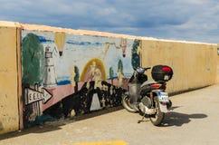 HERAKLION, GREECE - November, 2017: Motorcycle and graphite, optical illusion, Heraklion port, Crete. HERAKLION, GREECE - November, 2017: Real motorcycle on the Royalty Free Stock Photography