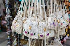 HERAKLION, GREECE - November, 2017: Women`s knitted handbags decorated with beads, Heraklion, Crete. HERAKLION, GREECE - November, 2017: Close-up: greek national Royalty Free Stock Images