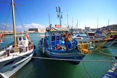 Heraklion, Greece, September 25, 2018, A fisherman sets up his fishing nets on his boat in the port stock image