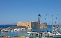 Heraklion harbor with Venetian Fortress (Koules) and modern marine, Crete Royalty Free Stock Photography
