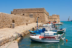 Heraklion harbour and castle. Crete, Greece. Fishing boats and Venetian Fortress in Heraklion harbour. Crete, Greece Stock Photos