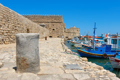 Heraklion harbour and castle. Crete, Greece. Fishing boats and Venetian Fortress in Heraklion harbour. Crete, Greece Royalty Free Stock Image