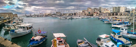 HERAKLION PORT - CRETE- INTRALEX 2016. HERAKLION PORT PANORAMIC VIEW WITH A HEAVY DRAMATIC SKY AND THE VENETIAN FORTRES ON THE LEFT SIDE Stock Photos