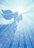 Herald angel. Angel blowing horn amidst celestial light Royalty Free Stock Image
