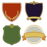 Heraldic coats of arms. Illustrated set of four heraldic coats of arms with copy space, white background Royalty Free Stock Image
