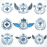 Heraldic decorative emblems made with royal crowns, animal illus. Trations, religious crosses, armory and medieval castles. Collection of symbols in vintage Stock Photos