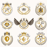 Heraldic decorative emblems made with royal crowns, animal illus Royalty Free Stock Photos