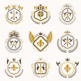 Heraldic decorative emblems made with royal crowns, animal illus Royalty Free Stock Photo