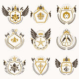 Heraldic decorative emblems made with royal crowns, animal illus Royalty Free Stock Images