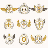 Heraldic decorative emblems made with royal crowns, animal illus Royalty Free Stock Image