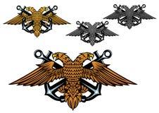 Heraldic eagle with a sea anchor in claws Stock Photos